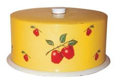 Metal cake cover, yellow lid with apple design. The same pattern was used on canister sets, flour sifters, etc., in the 1940s through the 1950s. Photo from the Antique Trader Antiques & Collectibles 2012 Price Guide - See more at: http://www.antiquetrader.com/antiques/antiques-americana/stacking-up-mid-century-kitchen-collectibles#sthash.LZMh6bvj.dpuf