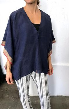 "Blue Linen top with a deep v and center seam Color:  Blue with gold border —  Length 27.5""   —  Width 43"" —  crewneck triangle detail at neckline —  one size fits size 2 to 10 — Free domestic shipping on purchases"