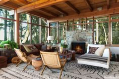 """Cool evenings make fires a must, even in summer. """"There's a camping-out feel that's very attractive,"""" designer Markham Roberts says of this living room in a Pacific Northwest home."""