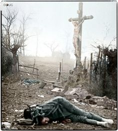 """Amid the appalling devastation and bodies of dead soldiers, a crucifix stands tall - miraculously preserved from the shell fire. This powerful image was captured after a bloody skirmish in 1917 by Walter Kleinfeldt a young German artilleryman. His son Volkmar, who has recently made available Walters photo collection says, """"This photograph is like an accusation - an accusation against war"""""""