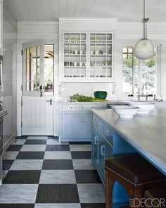 marble countertops, black and white tile floors, glass cabinets