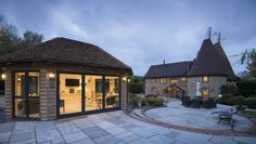 Origin are the UK's leading manufacturer of bespoke aluminium bi-folding doors and windows. Windows 20, Folding Doors, Gazebo, Ceiling, Outdoor Structures, Flooring, Mansions, The Originals, House Styles