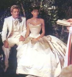 1999: VICTORIA BECKHAM Leave it to the most stylish Spice Girl to choose a timeless ivory gown for her wedding day. According to Business Insider, fashion designer Victoria Beckham wore a custom Vera Wang dress worth an estimated $100,000 for her July 4, 1999, nuptials to soccer superstar David Beckham.