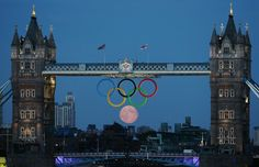The full moon rises through the Olympic Rings hanging beneath Tower Bridge during the London 2012 Olympic Games on August The moon appears to have taken a perfect position as the sixth ring of the Olympics logo. Full Moon Rising, Moon Rise, Moon Moon, Tower Bridge London, Perfectly Timed Photos, Timing Is Everything, Cinema, Perfect Timing, Olympic Games