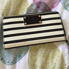 """Kate Spade Pasadena Neda striped wallet. Authentic, KSNY adorable and chic brand new wallet. Patent Leather Zip Around Wallet. 12 card slots 3 open compartments and 1 zippered compartment Back slip pocket. Measures 7.5"""" x 4"""" x 1"""" . There's a slight discolored spots in front as pictured. kate spade Bags Wallets"""