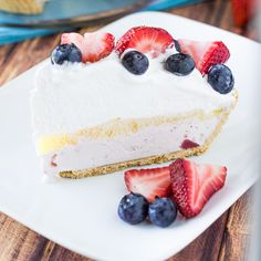 A recipe for a Very Berry Ice Cream Pie. Easy to make strawberry ice cream pie topped with fresh strawberries and blueberries for a perfect summer dessert.