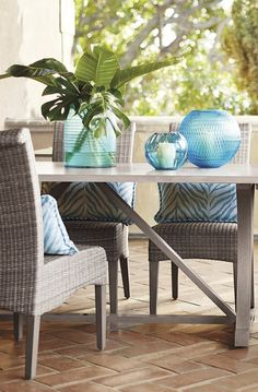 The rich, uninterrupted texture of the Madison Dining conveys the carefree beauty of cushionless living in all-weather wicker.  | Frontgate: Live Beautifully Outdoors