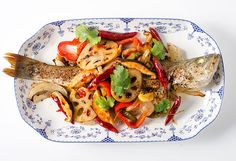 Chinese spicy roast fish recipe (重庆烤鱼, chong qing kao yu) - The fish is baked until crispy. The accompanying vegetables are cooked in Szechuan hot sauce.