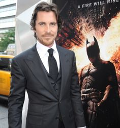 Christian Bale looking gorgeous in his high collared shirt.