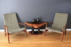 Pair of Danish Modern Lounge Chairs    This is a pair of beautiful vintage Mid-Century scoop chairs with sculptural walnut frames. They have been professionally reupholstered and are in great condition.