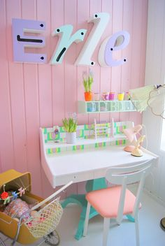 Love the mix of pastels and neons in this child's study space