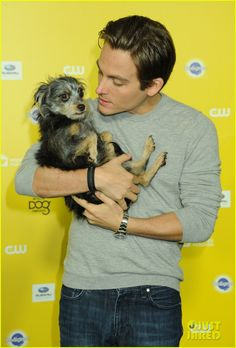 Kevin Zegers cradles his dog, Nugget, on the carpet as they arrive for the 2015 World Dog Awards held at Barker Hangar on Saturday night (January 10) in Santa Monica, Calif.