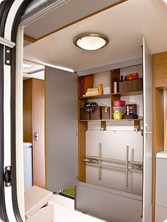 folding table stored in cabinet during travel