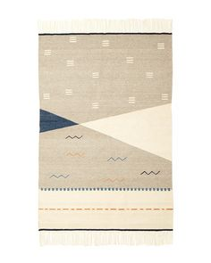 Made of bold shapes and subtle colors, the Wild Geese Rug in Grey was woven in a…