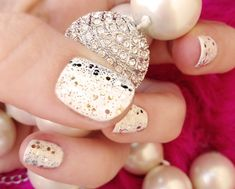 Whatever you do, don't forget to bring out the glitz and sparkle for New Year's Eve! | 11 Holiday-Themed Manicures You'll Want To Try Right Now