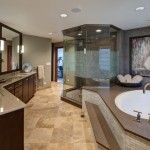 Massive master bathroom oasis with step-up tub and glass shower by Drury Design