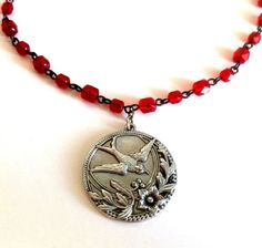 Ruby Swallow Medallion Necklace by EridaneasBoutique on Etsy