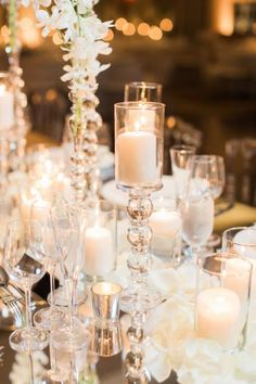 Chic and Contemporary modern wedding centerpiece, pillar candle centerpiece, mirror wedding table  from all white glamorous wedding at Four Seasons Georgetown