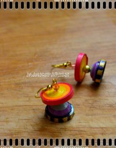 Quilled disc jhumka http://magicsparklz.blogspot.in/2015/04/quilled-disc-jhumka.html