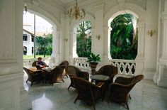 One of my favorite corners of the Raffles Hotel in Singapore.  Someday, I want a porch that looks like this!