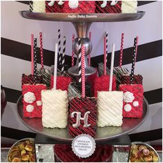 Wedding Rice Krispies treats in red, black and white on matching paper straw sticks.
