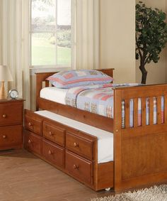 Double up on the sleeping arrangements with this space-saving trundle bed. Crafted in solid pine with a warm finish, it's just the start to a complete set including a two-drawer nightstand and coordinating chest of drawers.