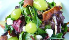 Sun World has delicious recipes for grapes like this mixed green and grapes salad with bacon, goat cheese, apple, and honeyed white wine vinaigrette.