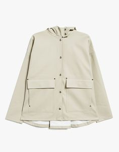 Contemporary raincoat from Stutterheim in Potato. Lightweight. Hooded design with drawstring adjustment. Dropped shoulders. Full snap button closure. Front patch pockets. Back fold. Double welded seams. Silver hardware. Subtle stamped branding at left hem
