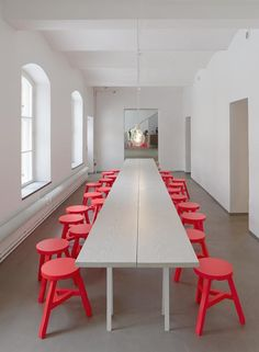 White Table with Red Stools.  I like this concept, but I'd rather have comfortable chairs so people would stay and eat.