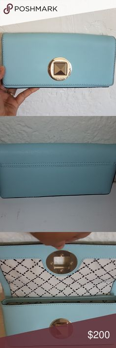 ✔Newbury Lane Keira✔ This a very beautiful, classy, elegant clutch that elevates any outfit you are wearing!! Day and night!! Only used it once. More like a Light Blue. It's in great condition! Clean. Has a compartment for cards and id.                        💓Smoke Free house                                            💓I am happy to take considerate offers, feel free to make an offer 😉 kate spade Bags Clutches & Wristlets