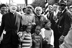 """3/7/1965: The first Selma to Montgomery March (""""Bloody Sunday"""") takes place. """"In 1965, a voter registration campaign focused in Selma, Alabama, began...[led by] Martin Luther King, Jr., the SNCC, and the SCLC. On March 7, a group of several hundred people set out from Selma on a 54-mile march toward Montgomery, but this protest was stopped short in a brief and violent confrontation (later known as """"Bloody Sunday"""") between the marchers and state troopers at the Edmund Pettis Bridge."""""""