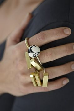 brass and silver rings. and one painted porcelain ball and silver ring.