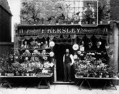 George Henry Terry (highlighted) above F. Kersley Florist in Woolwich, Kent, England (c. Victorian London, Vintage London, Old London, Victorian Era, Vintage Shops, London History, British History, Vintage Display, Vintage Photographs