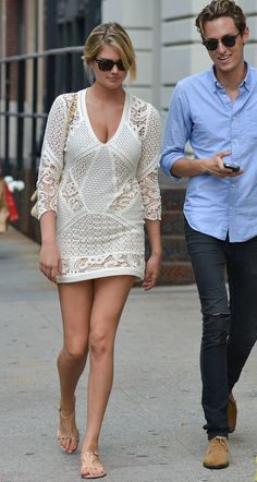 KATE UPTON IS A WHITE DRESS, RAY-BANS, CHANEL BAG, AND SEXY SANDALS