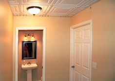 This basement stands out for all the right reasons! Bathroom Ceilings, Ceiling Tiles, Basement Remodeling, Bathroom Lighting, Home Improvement, Mirror, Furniture, Ideas, Home Decor