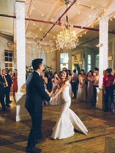 Bride and groom dancing under vintage chandelier and string lights Great Gatsby Wedding, Wedding Ideas, Vintage Chandelier, Bridesmaid Dresses, Wedding Dresses, String Lights, Dancing, Groom, Modern
