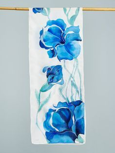 ******Perfect Holyday Gift***** Your scarf is entirely hand painted. I do the work by directly painting on silk with french dye and this gives the unique, non-reproducible value. Basically, a wearable piece of art. I never use guides or pre-design models. Inspired by blue Iris flowers this art piece uses the empty spaces to enhance the beauty of the brushstrokes and color diffusion. This piece is created in The Serti technique where a contour is traced prior to applying the dye in order to…