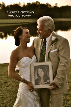 i wanna do this... with a pic of Daddy in my hands with my mom and my sissy.  ~ and a pic of mom and dad on their wedding day, with bobby holding a pic of his parents too.