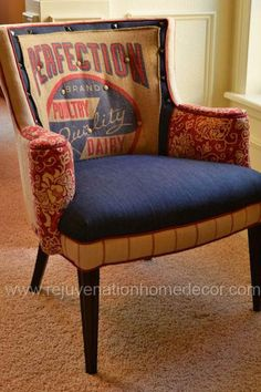 """This vintage chair has been refinished and reupholstered in a vintage grain sack is combined with denim, ticking stripe and red floral fabrics to create this one of a kind custom designed chair. DIMENSIONS: 28.5""""W X 27""""D X 33.5""""H. At Rejuvenation Home Decor."""