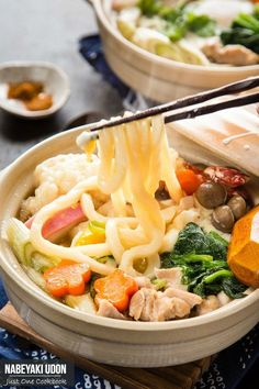 Fight the cold days with this steamy Nabeyaki Udon served in donabe. Topped with chicken, tempura & heaps of vegetables in an umami dashi soup, this hot noodle soup would be your favorite kind of winter comfort food. #hotpot #udonnoodlesoup #noodlesoup | Easy Japanese Recipes at JustOneCookbook.com
