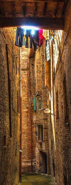 An ancient alley in Urbino, Italy http://www.castellodimonterado.it/en/il-territorio/