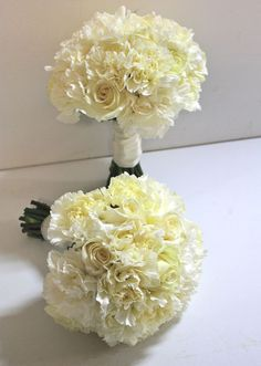 Possible Bridesmaids- White Carnations - But with the Light Pink Roses and Blush Ribbon For handle