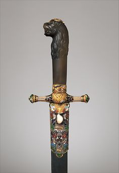 Hunting Sword Decorator: Emanuel Pioté (Austrian, Vienna 1781–1865) Decorator: Jacob H. Köchert (Austrian, Vienna 1795–1868) Date: ca. 1825 Geography: Vienna Culture: Austrian, Vienna Medium: Steel, gold, enamel, agate, wood, leather