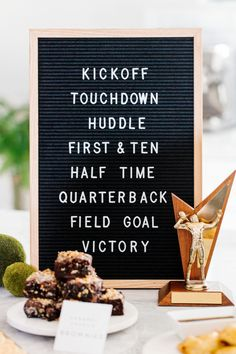 Isn't this letter board darling? It's the perfect decor for your Big Game party! We listed our favorite football terms and used an old trophy to compliment it! See more on The TomKat Studio!  #sponsored by kikkoman