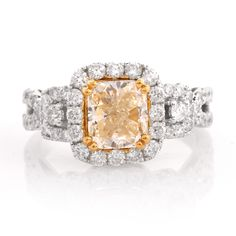 This modern engagement ring is crafted in solid white gold. It centers a natural fancy light yellow diamond approx: clarity, secured by four paw-prongs in yellow gold. The center stone is surrounded by a halo of round-faceted dia Yellow Diamond Engagement Ring, Modern Engagement Rings, Antique Engagement Rings, Colored Diamonds, Halo, 18k Gold, White Gold, Fancy, Crystals
