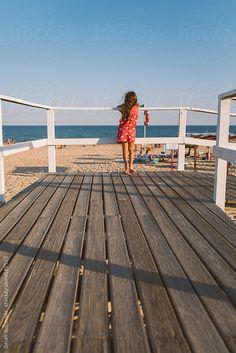 Child looking at the ocean by MelkiN | Stocksy United