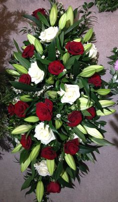 Coffin spray in red and white roses with lilies. #bishopandpolden