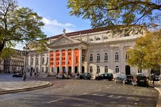 Sun shining on the National Theatre D.Maria II (Teatro Nacional D.Maria II) in Pedro IV/ Rossio Square, Lisbon, Portugal... Select image to see more.