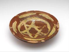 dish , 1400 - 1425 diam. 27.5 cm slip decoration, lead glaze, redware (Europe > Western Europe > The Netherlands > South Holland > Leiden)