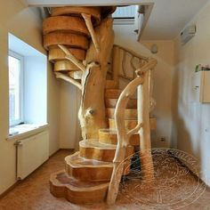"""One of the more creative and beautiful hand made """"stairways to heaven (the warmer part of the home:0)""""  I have ever seen.  It wouldn't be any fun to take the grand piano to the second floor, but spiral staircases are for beauty/space saving and not for utility.  This comes courtesy of the FB page of Woodworking Tips.  To place this beauty in a cordwood home visit www.cordwoodconstruction.org"""